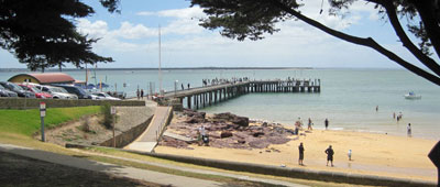 beautiful cowes beach and pier. Lots of tourist cruises around Philip Island.