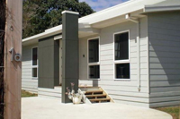 Image of the front of the cowes retreat holiday house showing front door and front decking.