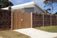 Front of the cowes retreat holiday house showing privacy fencing around front of property.